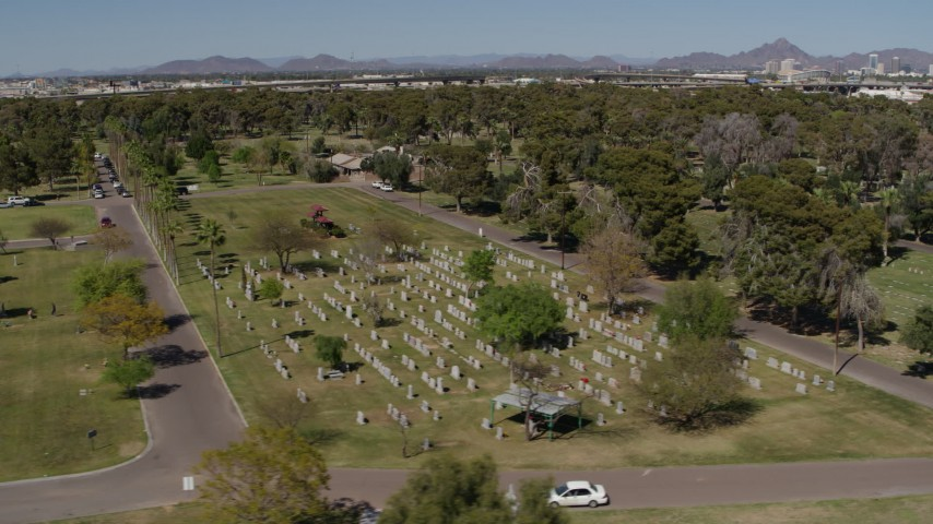 5.7K stock footage aerial video orbiting green lawn and gravestones at a cemetery in Phoenix, Arizona Aerial Stock Footage | DX0002_137_026