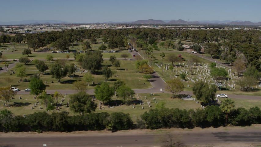 5.7K stock footage aerial video flyby green lawn and gravestones at a cemetery in Phoenix, Arizona Aerial Stock Footage | DX0002_137_027
