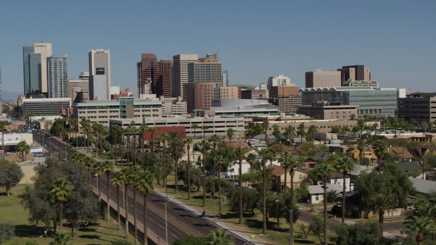 5.7K stock footage aerial video of passing tall office buildings in Downtown Phoenix, Arizona Aerial Stock Footage | DX0002_137_033
