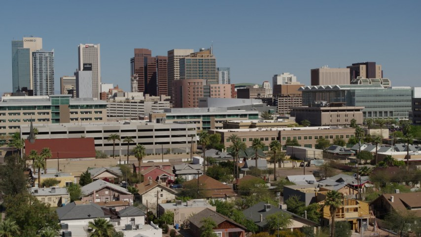 5.7K stock footage aerial video approach tall office buildings in Downtown Phoenix, Arizona Aerial Stock Footage | DX0002_137_034