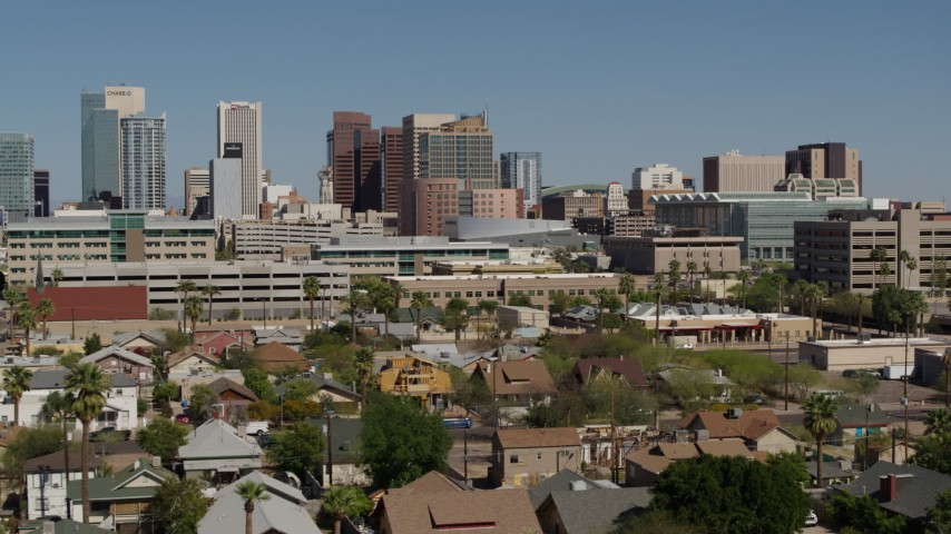 5.7K stock footage aerial video fly away from tall office buildings in Downtown Phoenix, Arizona Aerial Stock Footage | DX0002_137_035