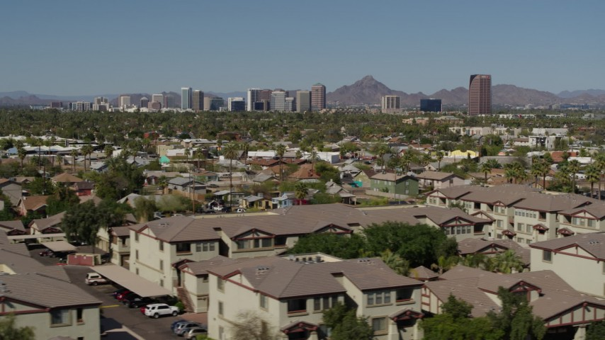 5.7K stock footage aerial video a view of tall office buildings seen from city park and apartment buildings in Phoenix, Arizona Aerial Stock Footage | DX0002_137_042