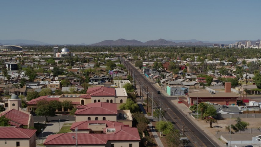 5.7K stock footage aerial video flying by 15th Avenue and residential neighborhood in Phoenix, Arizona Aerial Stock Footage | DX0002_137_043