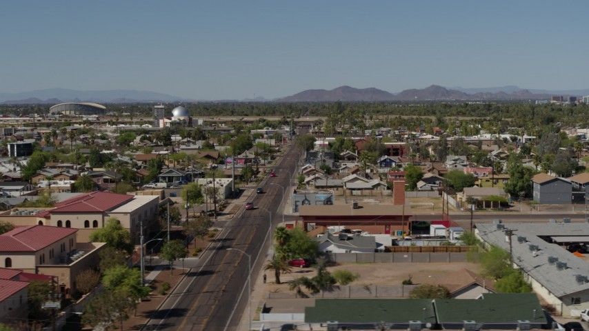 5.7K stock footage aerial video flying by neighborhoods around 15th Avenue in Phoenix, Arizona Aerial Stock Footage | DX0002_137_044