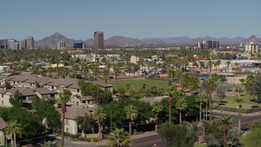 5.7K stock footage aerial video distant BMO Tower seen while passing by University Park in Phoenix, Arizona Aerial Stock Footage | DX0002_137_046