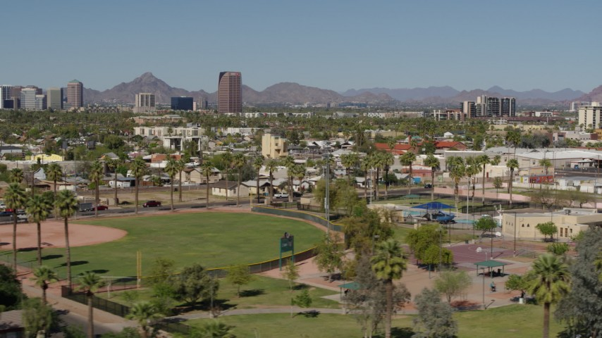 5.7K stock footage aerial video BMO Tower seen from University Park in Phoenix, Arizona Aerial Stock Footage | DX0002_137_048