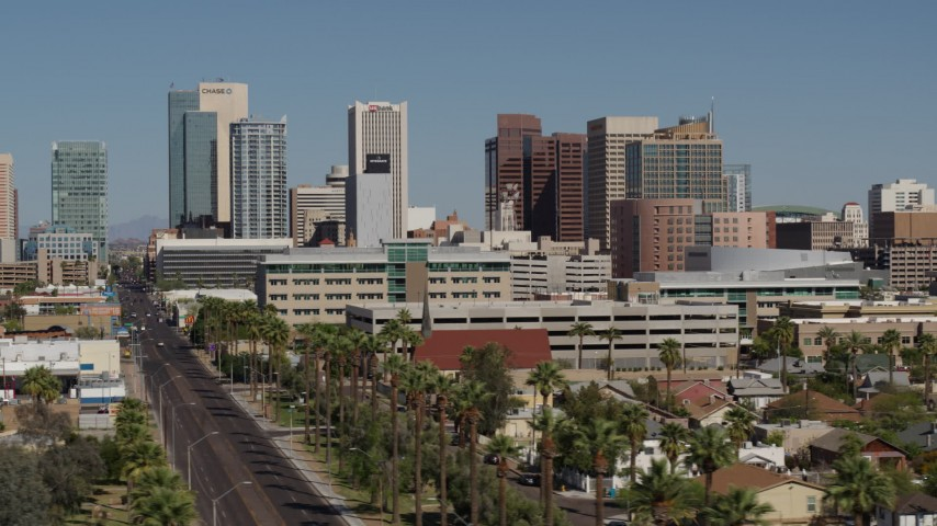5.7K stock footage aerial video of tall office buildings seen from Van Buren Street in Downtown Phoenix, Arizona Aerial Stock Footage   DX0002_137_049
