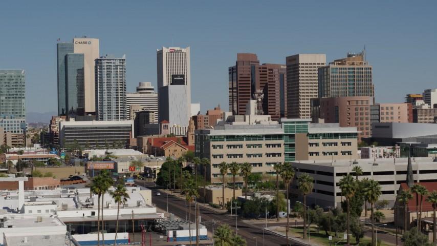 5.7K stock footage aerial video slow approach to tall office buildings, seen from Van Buren Street in Downtown Phoenix, Arizona Aerial Stock Footage | DX0002_137_050