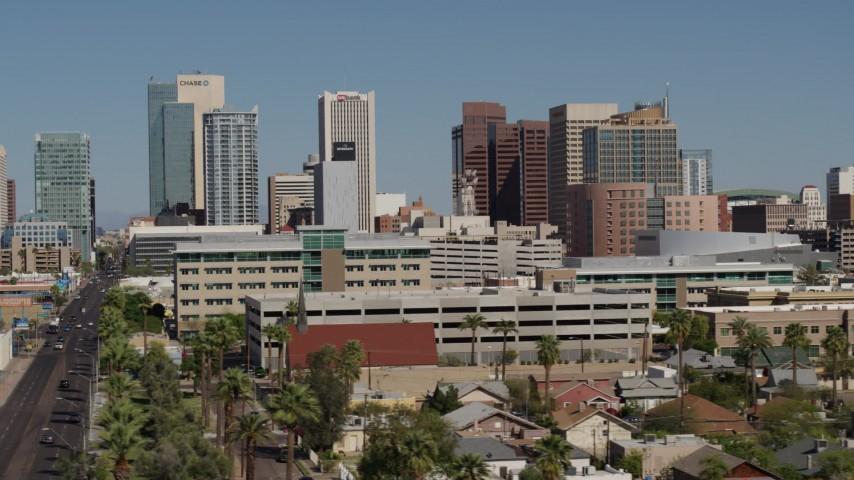 5.7K stock footage aerial video of towering office buildings seen while flying near Van Buren Street in Downtown Phoenix, Arizona Aerial Stock Footage | DX0002_137_051