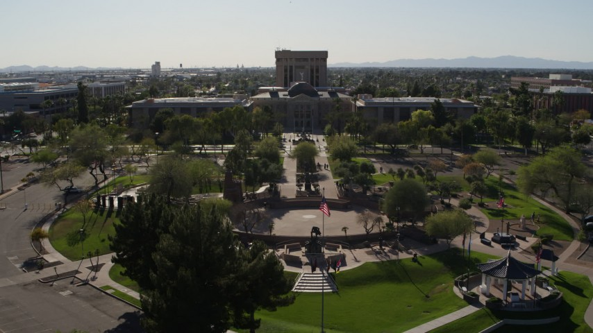 5.7K stock footage aerial video reverse view of plaza and the Arizona State Capitol building in Phoenix, Arizona Aerial Stock Footage | DX0002_138_005