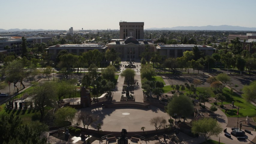 5.7K stock footage aerial video fly over plaza toward the Arizona State Capitol in Phoenix, Arizona Aerial Stock Footage | DX0002_138_006
