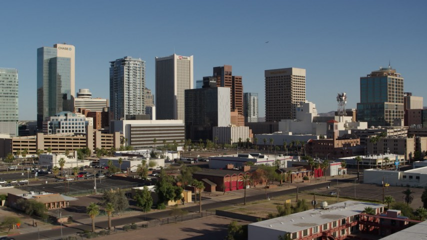 5.7K stock footage aerial video flying by the city's high-rise office buildings in Downtown Phoenix, Arizona Aerial Stock Footage   DX0002_138_008