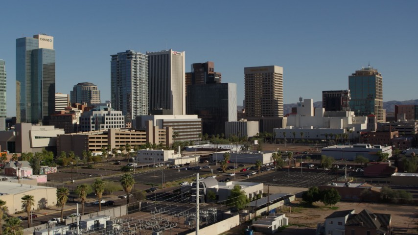 5.7K stock footage aerial video passing by the city's high-rise office buildings in Downtown Phoenix, Arizona Aerial Stock Footage | DX0002_138_009