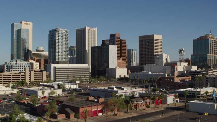5.7K stock footage aerial video reverse view of the city's high-rise office buildings in Downtown Phoenix, Arizona Aerial Stock Footage | DX0002_138_010