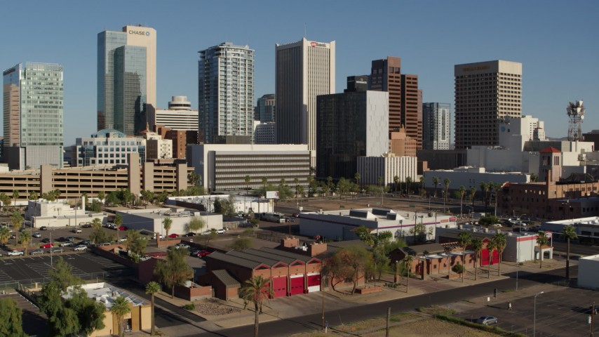 5.7K stock footage aerial video slowly flying away from the city's high-rise office buildings in Downtown Phoenix, Arizona Aerial Stock Footage | DX0002_138_013