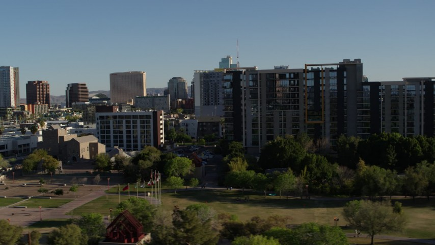 5.7K stock footage aerial video passing cultural center, hotel and condo complex in Downtown Phoenix, Arizona Aerial Stock Footage | DX0002_138_020