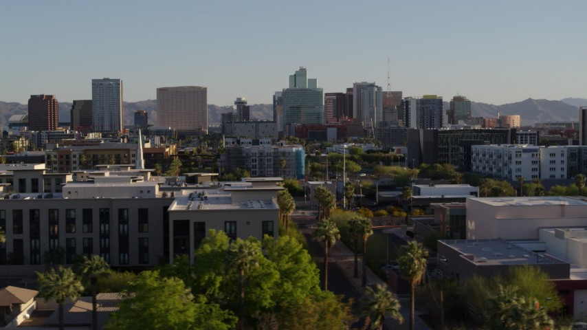 5.7K stock footage aerial video of a view of high-rise office buildings in the distance in Downtown Phoenix, Arizona Aerial Stock Footage DX0002_138_031