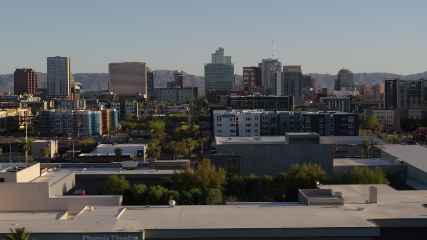 5.7K stock footage aerial video of high-rise office buildings in the distance in Downtown Phoenix, Arizona Aerial Stock Footage | DX0002_138_032