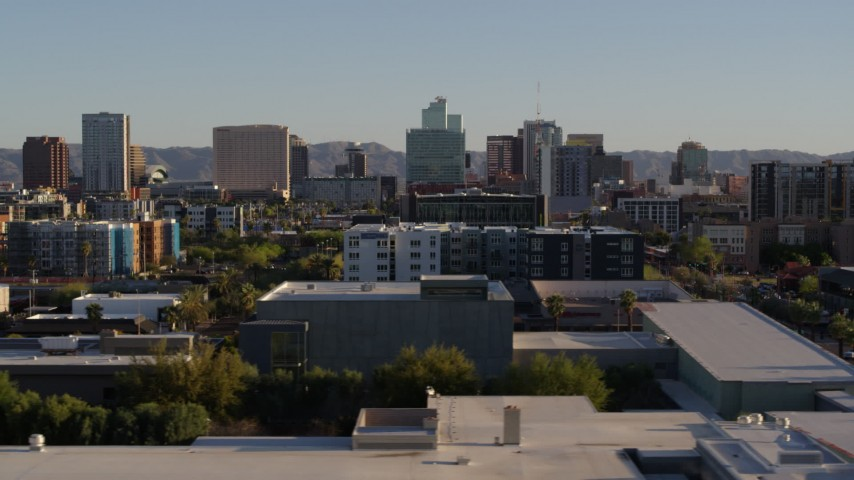 5.7K stock footage aerial video of high-rise office buildings seen from apartment buildings in Downtown Phoenix, Arizona Aerial Stock Footage | DX0002_138_035