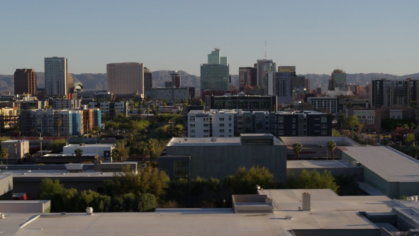 5.7K stock footage aerial video of high-rise office buildings seen while flying by apartment buildings in Downtown Phoenix, Arizona Aerial Stock Footage | DX0002_138_036