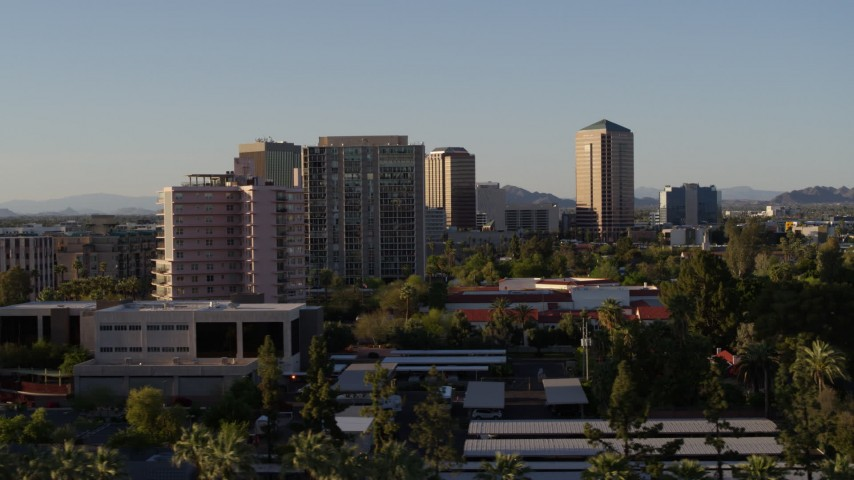 5.7K stock footage aerial video of flying by high-rise apartment buildings in Phoenix, Arizona Aerial Stock Footage | DX0002_138_037