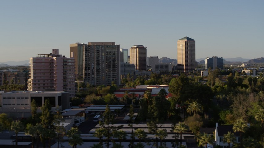 5.7K stock footage aerial video of passing by high-rise apartment buildings, focus on office buildings in Phoenix, Arizona Aerial Stock Footage | DX0002_138_038