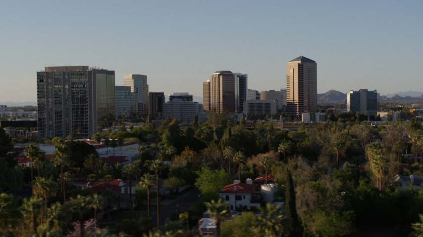 5.7K stock footage aerial video of office buildings seen while passing trees and apartment buildings in Phoenix, Arizona Aerial Stock Footage | DX0002_138_039