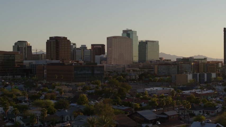 5.7K stock footage aerial video of a hotel flanked by high-rise office buildings at sunset in Downtown Phoenix, Arizona Aerial Stock Footage | DX0002_138_046