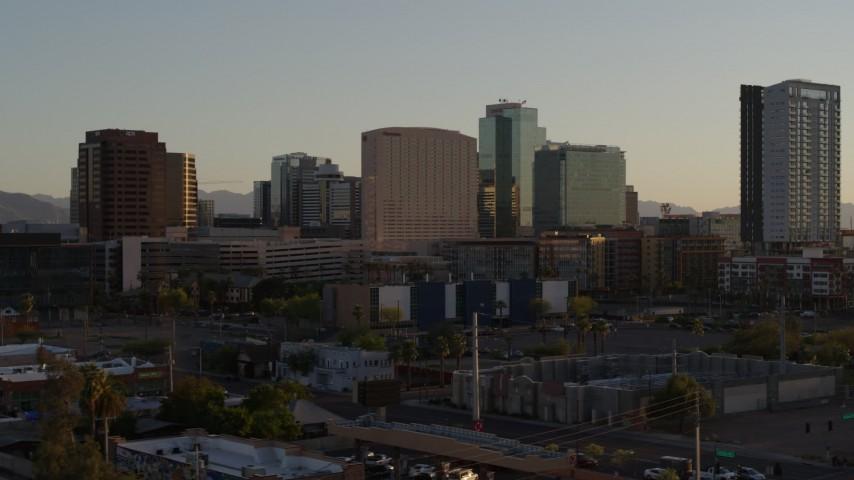 5.7K stock footage aerial video reverse view and flyby of a hotel and high-rise office buildings at sunset in Downtown Phoenix, Arizona Aerial Stock Footage | DX0002_138_047