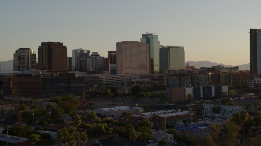5.7K stock footage aerial video of reverse view of a hotel and high-rise office buildings at sunset in Downtown Phoenix, Arizona Aerial Stock Footage | DX0002_138_048
