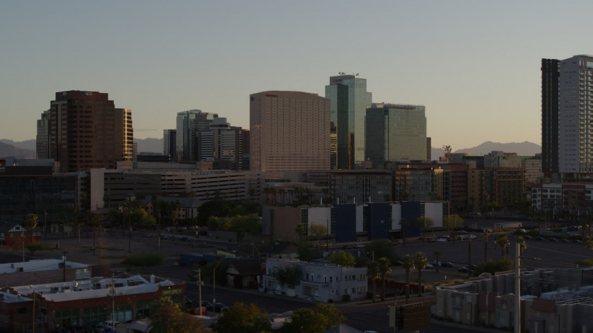 5.7K stock footage aerial video of a hotel and tall office buildings at sunset in Downtown Phoenix, Arizona Aerial Stock Footage | DX0002_138_049