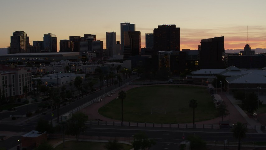 5.7K stock footage aerial video of tall office high-rises seen from a sports field in Downtown Phoenix, Arizona Aerial Stock Footage | DX0002_139_007