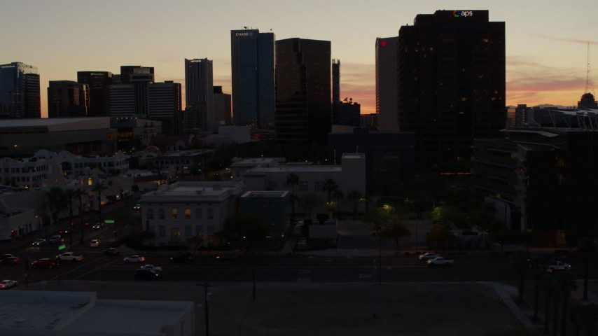 5.7K stock footage aerial video of slowly passing tall office high-rises at sunset in Downtown Phoenix, Arizona Aerial Stock Footage | DX0002_139_009