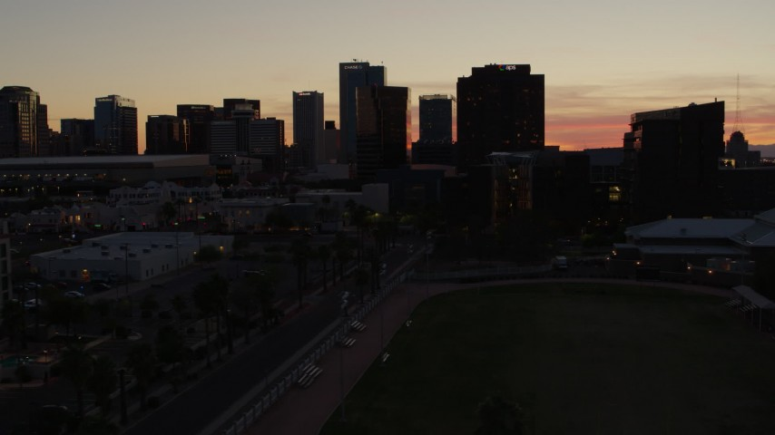 5.7K stock footage aerial video reverse view and flyby tall office high-rises at sunset in Downtown Phoenix, Arizona Aerial Stock Footage | DX0002_139_010
