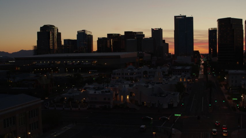 5.7K stock footage aerial video fly toward and past tall office high-rises at sunset in Downtown Phoenix, Arizona Aerial Stock Footage | DX0002_139_013
