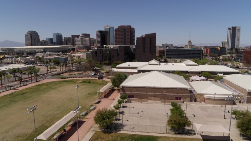 5.7K stock footage aerial video of orbiting a charter school to reveal city's skyline in Downtown Phoenix, Arizona Aerial Stock Footage | DX0002_140_002