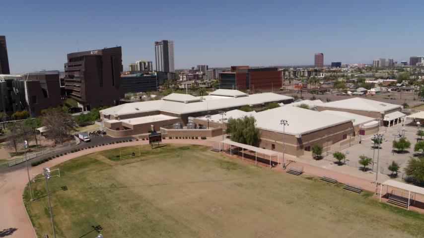 5.7K stock footage aerial video of orbiting a charter school near the city's skyline in Downtown Phoenix, Arizona Aerial Stock Footage | DX0002_140_003