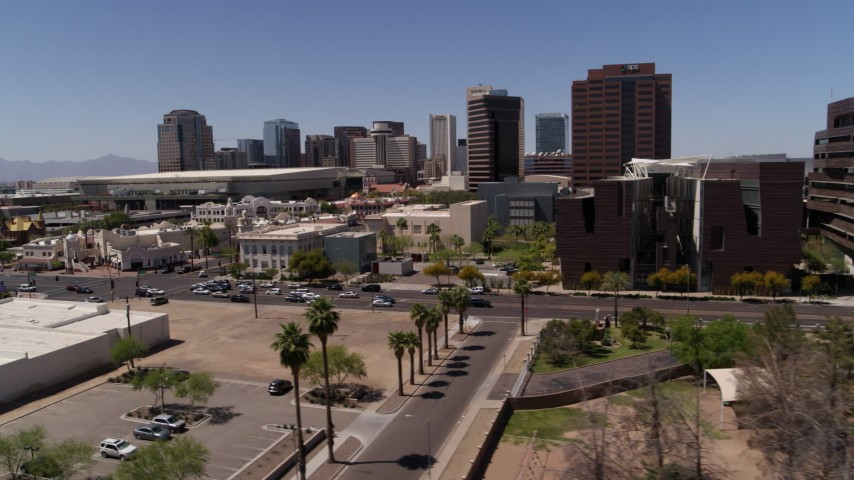 5.7K stock footage aerial video flyby college buildings to focus on city's skyline in Downtown Phoenix, Arizona Aerial Stock Footage | DX0002_140_005