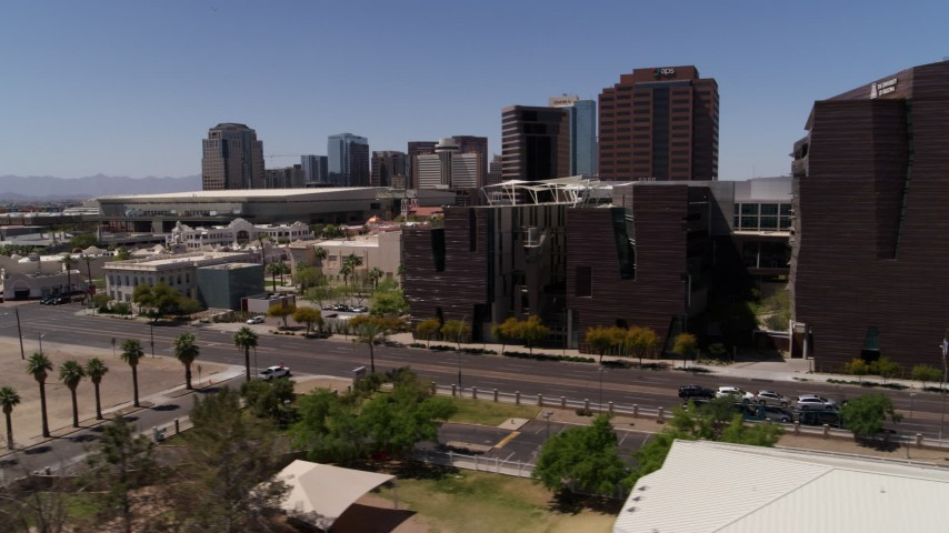 5.7K stock footage aerial video flyby city's skyline to reveal college buildings in Downtown Phoenix, Arizona Aerial Stock Footage | DX0002_140_006