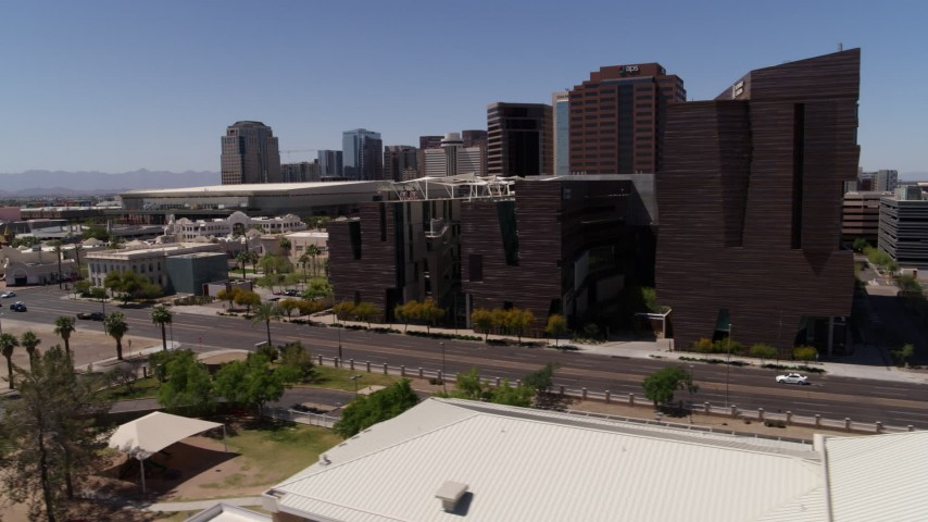 5.7K stock footage aerial video flyby college buildings to reveal the city's skyline in Downtown Phoenix, Arizona Aerial Stock Footage | DX0002_140_007