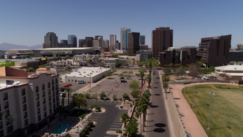 5.7K stock footage aerial video flying away from city's skyline to reveal college buildings in Downtown Phoenix, Arizona Aerial Stock Footage | DX0002_140_008