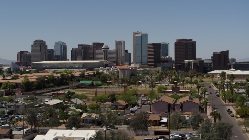 5.7K stock footage aerial video of flying by the city's skyline, seen from homes in Downtown Phoenix, Arizona Aerial Stock Footage | DX0002_140_010
