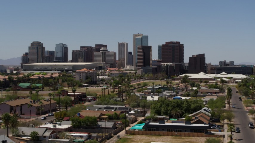 5.7K stock footage aerial video of passing by the city's skyline, seen from homes in Downtown Phoenix, Arizona Aerial Stock Footage | DX0002_140_011