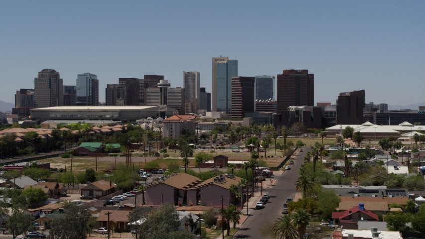 5.7K stock footage aerial video of flying by and away from the city's skyline, seen from homes in Downtown Phoenix, Arizona Aerial Stock Footage | DX0002_140_012