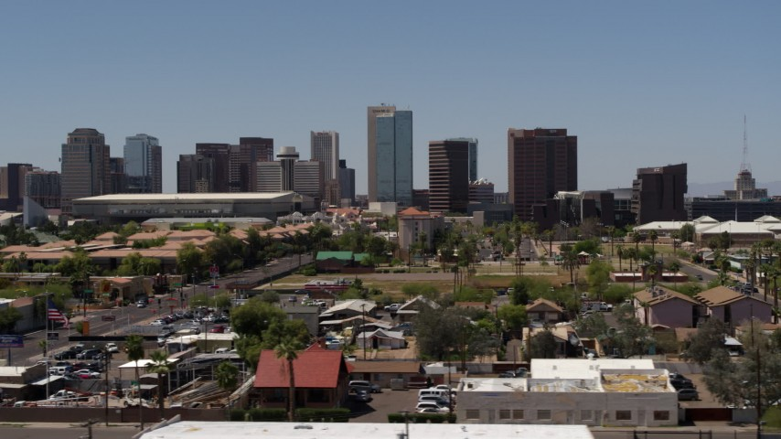 5.7K stock footage aerial video of flying by the city's skyline, and then away from it, seen from homes in Downtown Phoenix, Arizona Aerial Stock Footage | DX0002_140_013