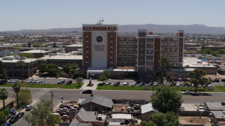5.7K stock footage aerial video orbit the Maricopa Medical Center and then fly away, Phoenix, Arizona Aerial Stock Footage | DX0002_140_018