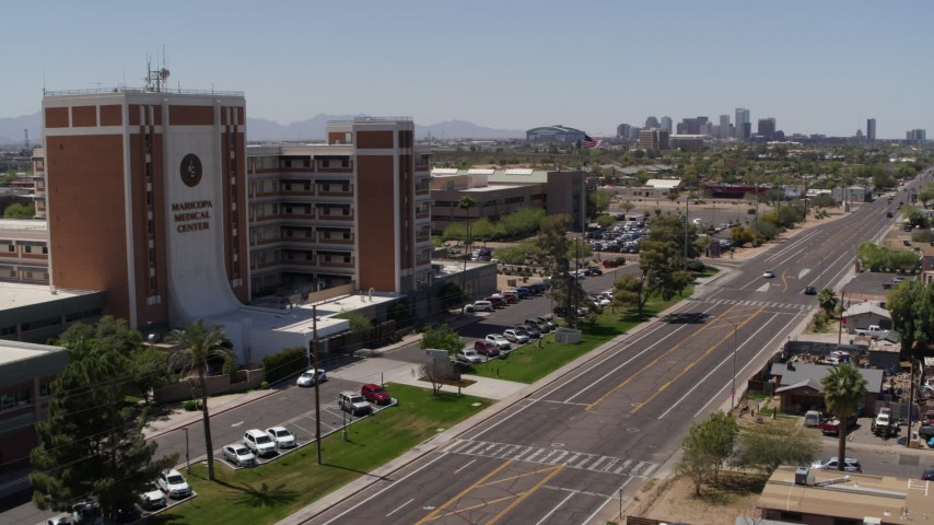 5.7K stock footage aerial video pan from street and skyline to hospital complex in Phoenix, Arizona Aerial Stock Footage | DX0002_140_022