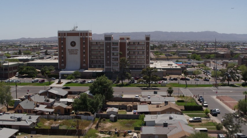 5.7K stock footage aerial video a reverse view of a hospital complex in Phoenix, Arizona Aerial Stock Footage | DX0002_140_023