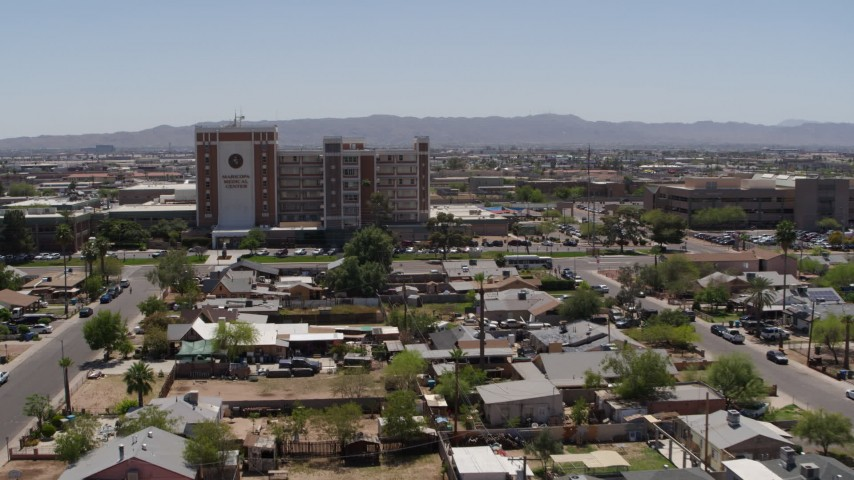 5.7K stock footage aerial video orbit and the approach a hospital complex in Phoenix, Arizona Aerial Stock Footage | DX0002_140_024
