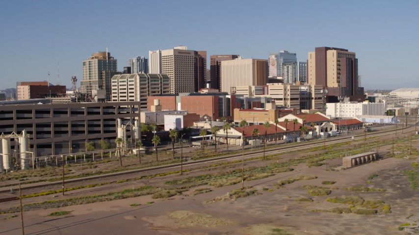 5.7K stock footage aerial video of the city's skyline seen from a parking garage and train station in Downtown Phoenix, Arizona Aerial Stock Footage | DX0002_142_015